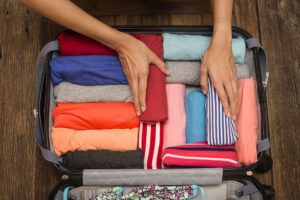 rolling-clothes-in-your-suitcase-300x200