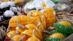 videoblocks-colorful-thai-handmade-soap-in-the-form-of-exotic-fruit-on-the-counter-night-market-thailand_rwdiw7zdg_thumbnail-full01