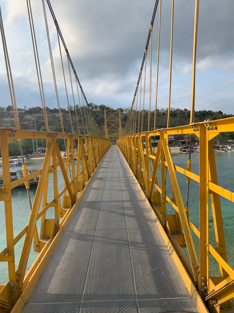 Yellow Bridge or Bridge of Love connecting Nusa Lembongan and Nusa Ceningan